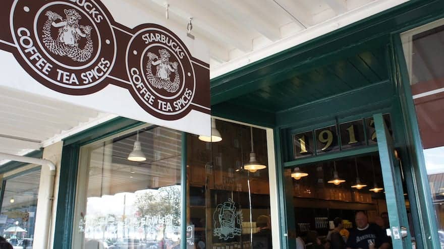 Sign showing coffee, tea and spices available at original Pike Place Starbucks