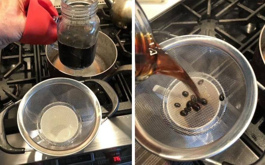 Lifting coffee from simmering water and straining into cup