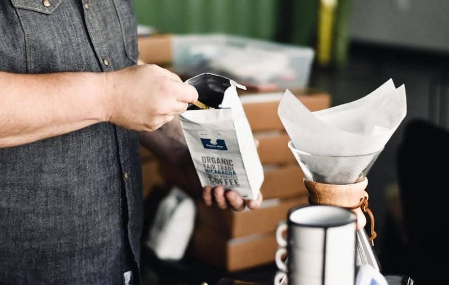 Scooping organic coffee into a filter