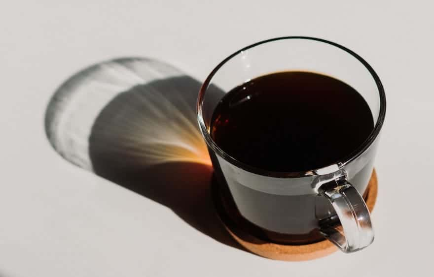 Dark coffee in a clear glass cup