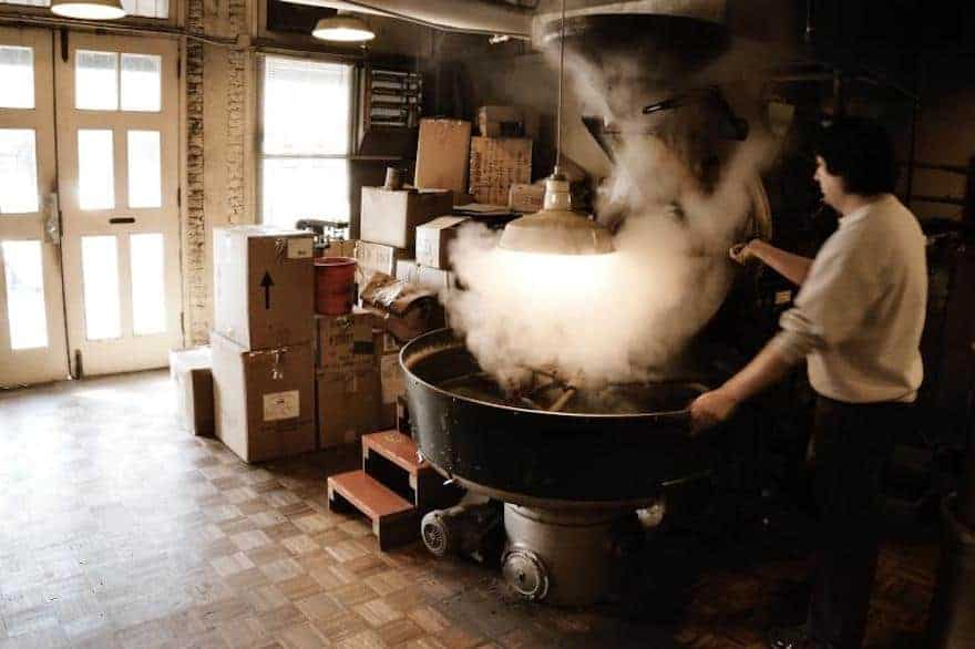 Smoke rising from a coffee roaster
