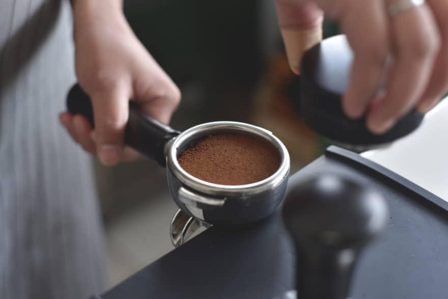 Tamping an espresso into a portafilter.