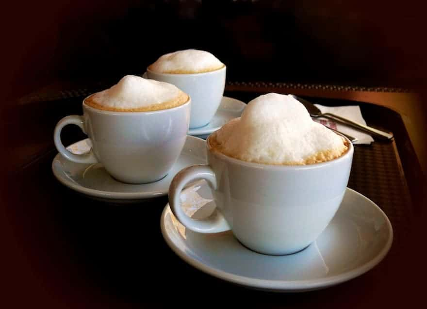 Three cups of cappuccino
