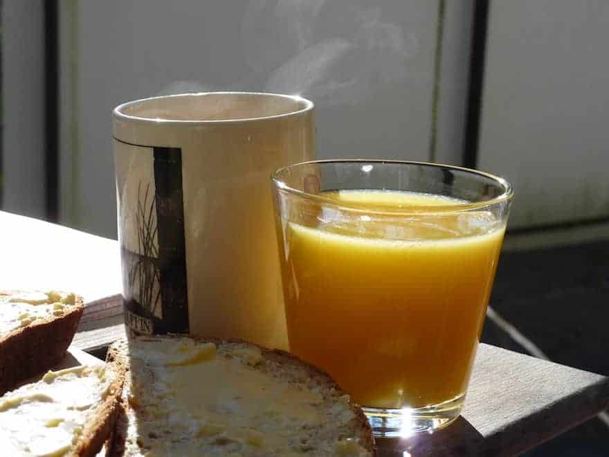 Coffee and orange juice side by side