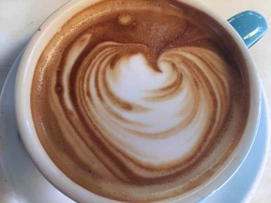 View of a flat white coffee from above
