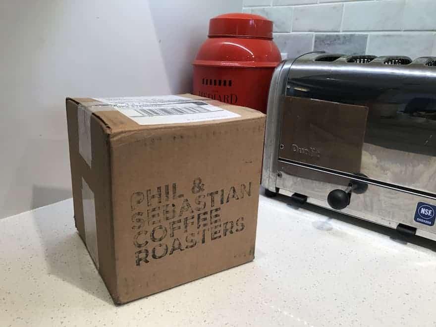 cardboard box containing coffee from Phil & Sebastian Coffee Roasters