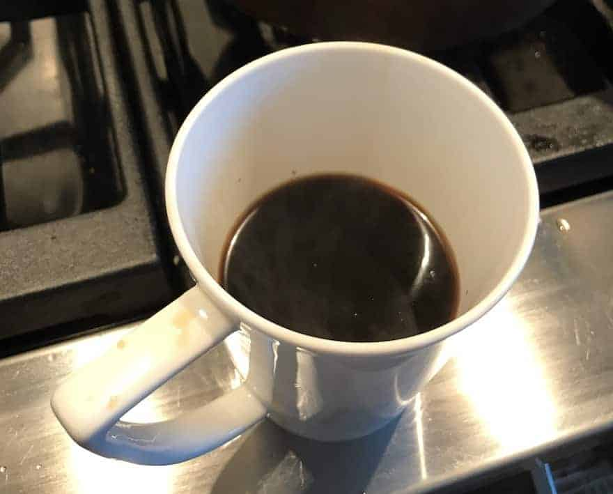 Cup of coffee brewed from whole beans