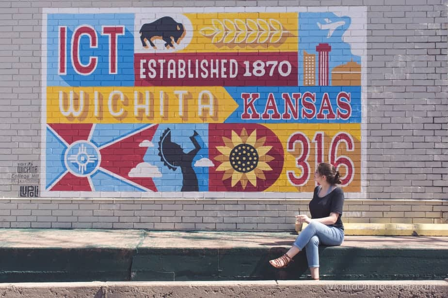 Enjoying a coffee and looking at a Wichita mural