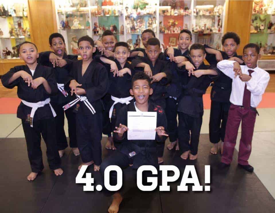 """So proud of Jason getting a 4.0 GPA on his report card and how his """"Cave brothers"""" celebrated his achievement by holding up A's!"""