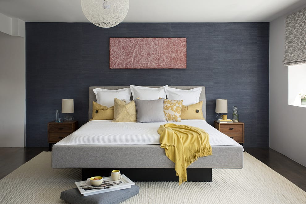 grey and yellow bedroom with charcoal grey accent wall