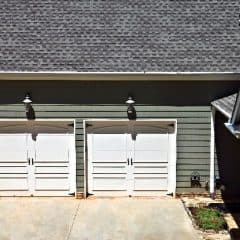 Attached garage on  a house showing the doors.