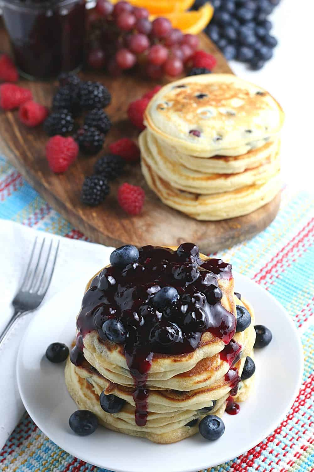 Start your morning off with a delicious batch of Blueberry Buttermilk Pancakes from scratch. This light and fluffy blueberry pancake recipe is perfect for blueberry season or all year round.