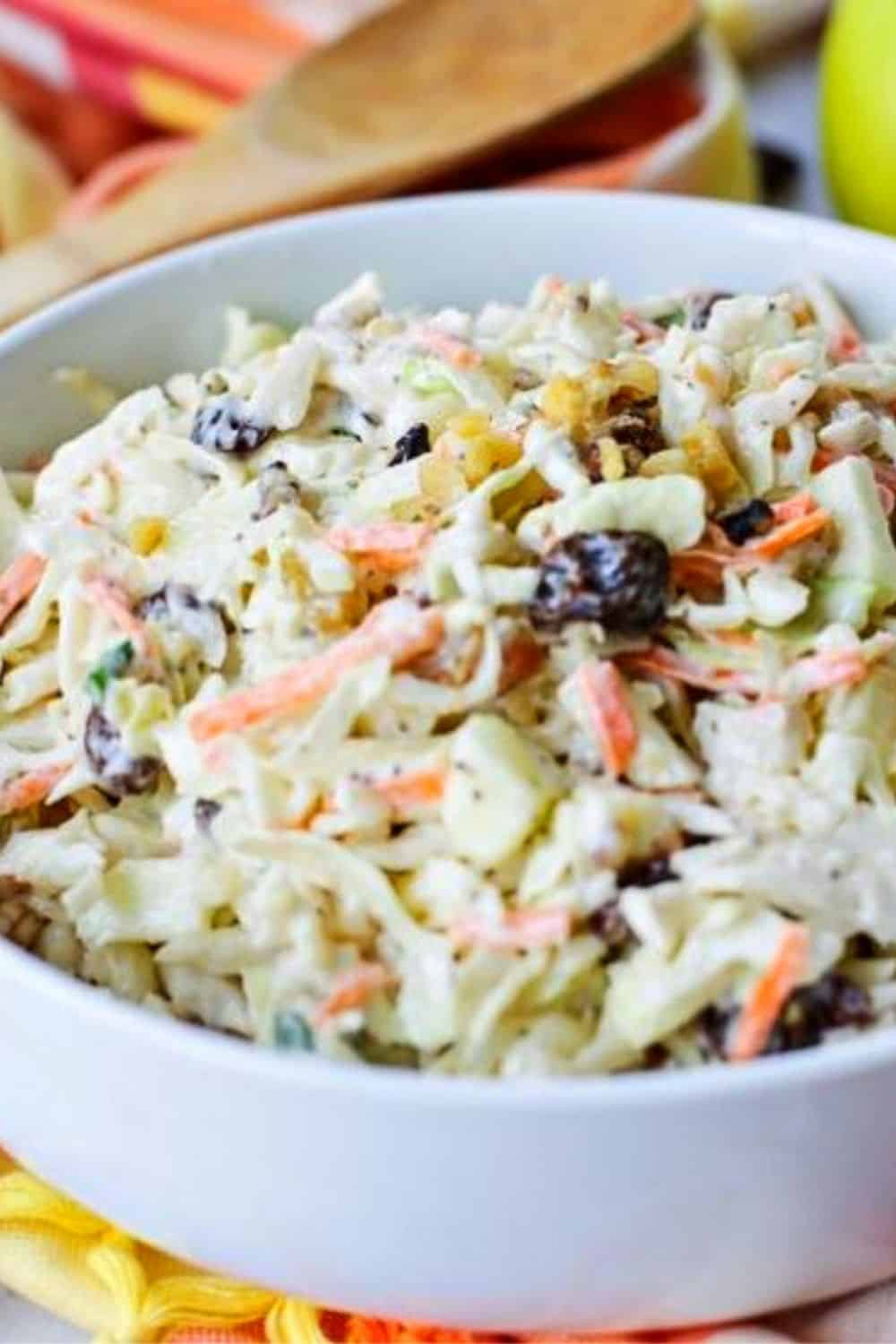Coleslaw isn't just for picnics. Take your coleslaw to a new level with this tasty Homemade Apple Raisin Coleslaw. This homemade coleslaw recipe is the perfect side dish to serve any time of year. Ready in just 10 minutes, this delicious southern coleslaw recipe is topped with a creamy homemade dressing. It's the perfect blend of sweet and savory. #coleslaw #easyrecipe #homemadecoleslaw