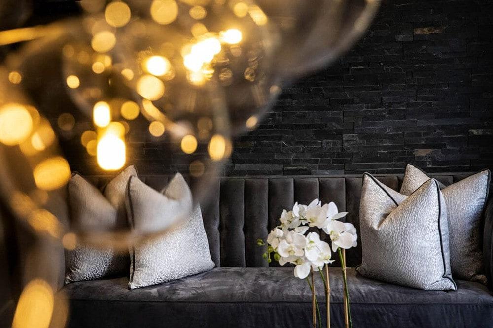 luxury interior design photos of purple sofa and velvet cushions