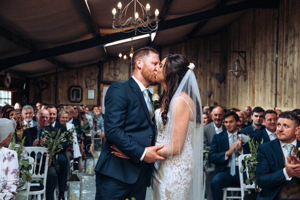 dove barn wedding ceremony with bride and groom