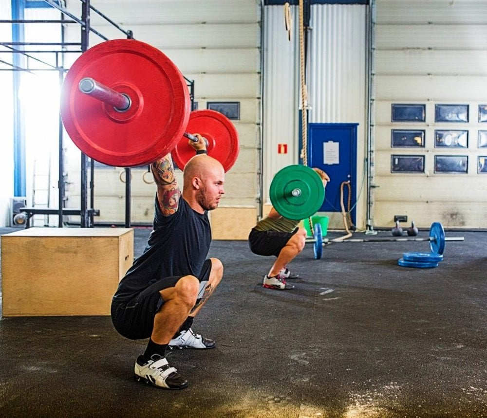 man and woman at crossfit gym
