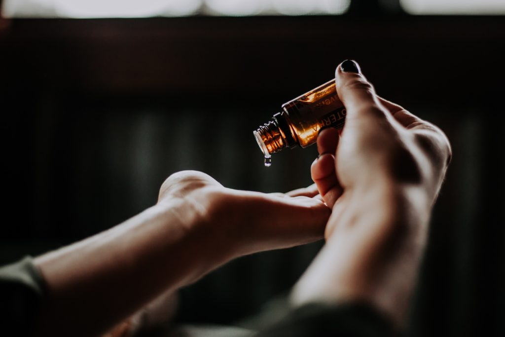 Person using essential oils