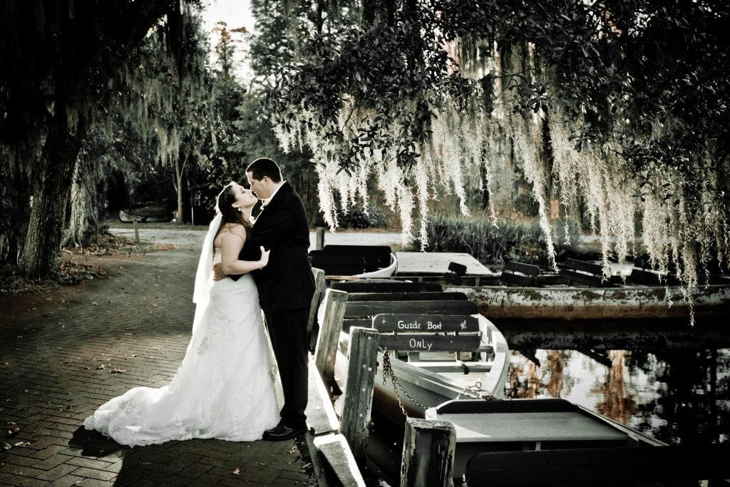 black and white photo of married couple under an oak tree