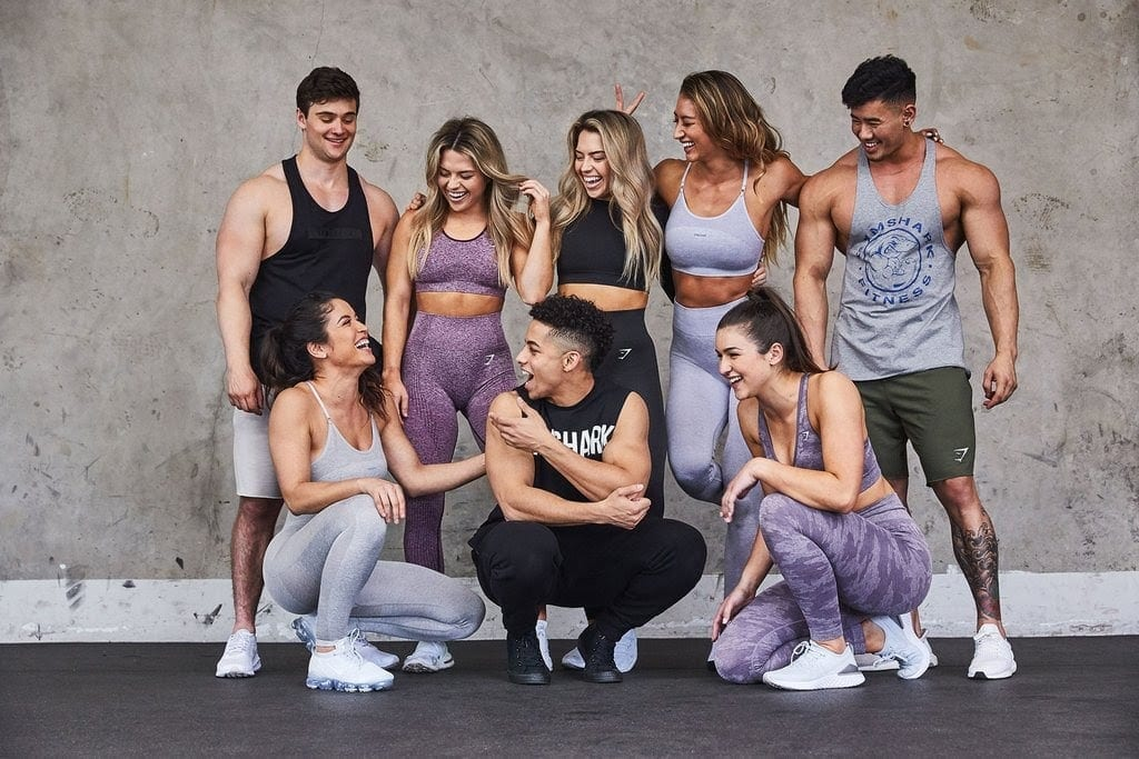 A group of young people wearing Gymshark leggings and sportswear