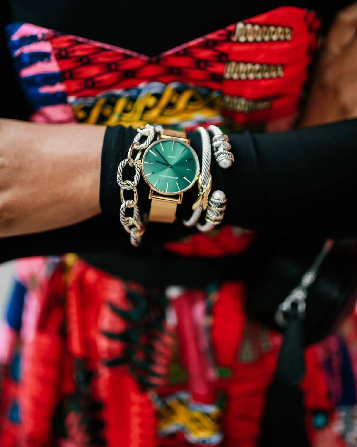 Chain link bracelets and adjustable bangles from Amazon paired with stunning mesh watch with vibrant green face