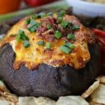 Looking for the perfect cheesy party dip? Well, look no further. This Bacon Cheddar Bread Bowl Dip is the perfect way to get the party started. #HeluvaGoodSummer #Ad #IC