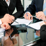 Attorneys and Client discussing Chapter 7 Bankruptcy qualifications
