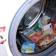 Money in a washing machine, getting laundered