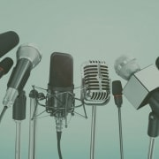 microphones at a press briefing