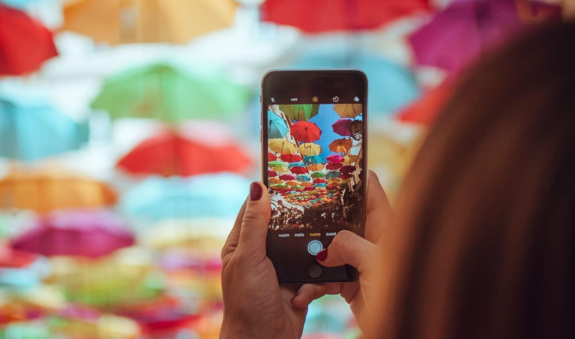 Girl taking a photo on her phone for social media