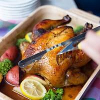 Hands carving sweet tea brined chicken