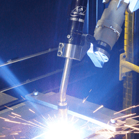 TOUGH GUN CA3 robotic air-cooled MIG gun in action with colorful welding sparks