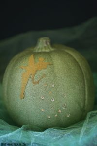 Celebrate Halloween with a little faith, trust, and this Tinker Bell Illuminated Pixie Dust Pumpkin. Create your own with this easy tutorial.