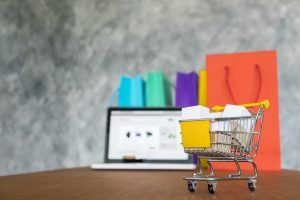 laptop and shopping bags, online shopping concept