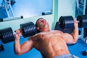 man dumbbell pressing weight