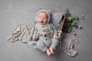 Baby boy yawning in grey romper, SR Portraits Newborn Photography