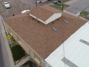 top view of Brighton Fire Department with brown asphalt shingle roofing