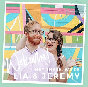 Travel bloggers Lia and Jeremy in front of a colorful background with welcoming text.