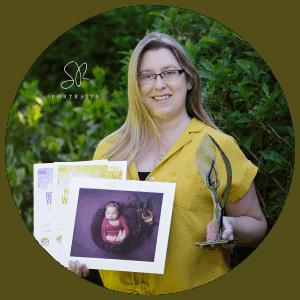 Sandra Ramp Award winner Midlands Newborn Photographer of the Year 2021. Holding certificates and trophy
