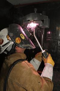 Image of a welder using a self-shielding application