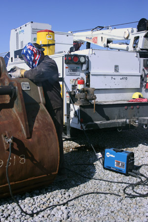 Image of a novice welder in front of a work truck