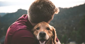 Dog in an embrace with a guy