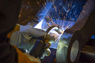 Application photo of a welder in the process of welding