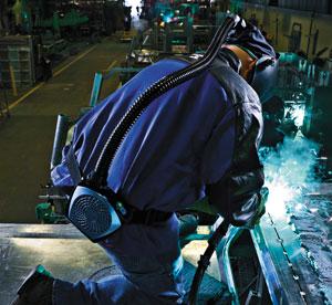 Image of a welder wearing a cool belt
