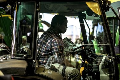 2017-05-16 08:48:16 A visitor sits in the cabin of a farming vehicle while visiting a stand at the Nampo Harvest Day 2017 agricultural show on May 16, 2017 in Bothaville.  Nampo is the largest agricultural fair on the African continent holding its 51st edition with over 700 exhibitors and over 70,000 visitors expected. MARCO LONGARI / AFP