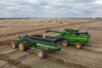 The OMNiDRIVE system allows growers to remotely set a field plan, establish staging locations, adjust speeds, monitor location activity, and command the tractor pulling a grain cart to sync with the harvester. - Photo: Raven