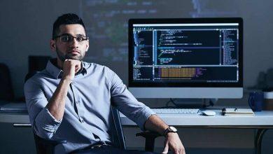 software developer sitting near a PC screen