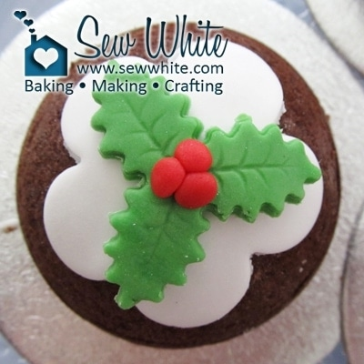 Holly berries and holly leaves on the Christmas Pudding Cakes