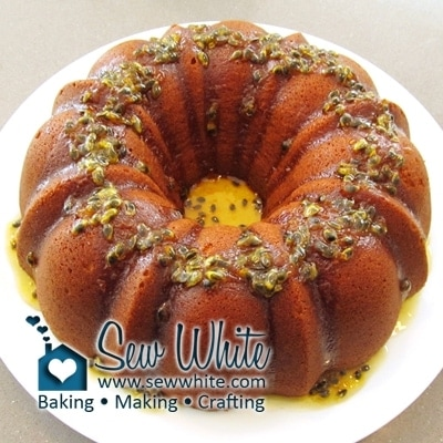 Passion fruit bundt cake drizzled with passionfruit drizzle ready to be eaten
