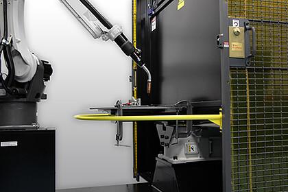Image of MIG gun in robotic welding cell