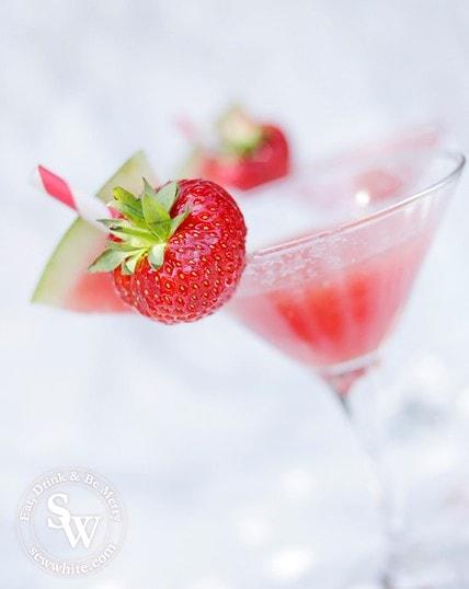 watermelon slice and strawberry on a martini glass